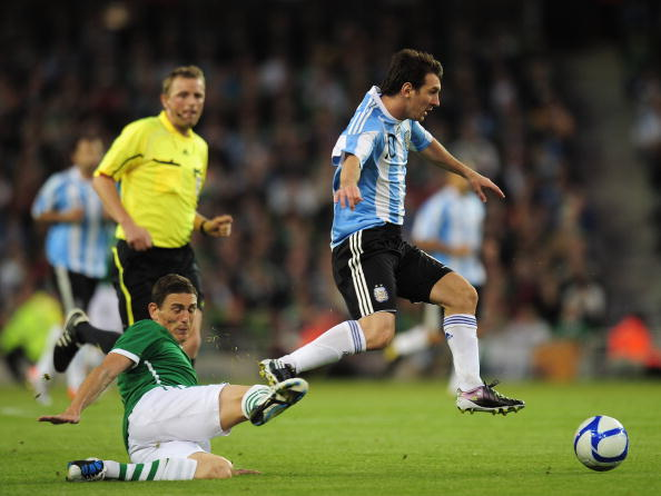 DUBLIN, IRELAND - AUGUST 11:  Lionel Messi of Argentina avoids a challenge from Keith Andrews of Republic of Ireland during the International Friendly match between Republic of Ireland and Argentina at the Aviva Stadium on August 11, 2010 in Dublin, Ireland.  (Photo by Shaun Botterill/Getty Images)