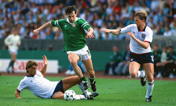 STUTTGART - JUNE12: Republic of Ireland's Tony Galvin (C) skips past the challenge of  England's Glenn Hoddle (l) and Gary Stevens during the European Championships match between England and Republic of Ireland on June 12, 1988 in Stuttgart, West Germany. (Photo by Allsport/Getty Images)