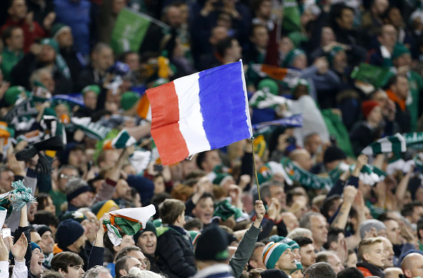 DUBLIN, REPUBLIC OF IRELAND - NOVEMBER 16:  A French flag is held by an Irish supporter in memory of victims of the Paris terror attacks during the UEFA EURO 2016 qualifier play-off second leg match between Republic of Ireland and Bosnia and Herzegovina at Aviva Stadium on November 16, 2015 in Dublin, Republic of Ireland. (Photo by Jean Catuffe/Getty Images)