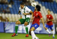Serbia's Bisevac challenges Ireland's Walters during their international friendly soccer match in Belgrade