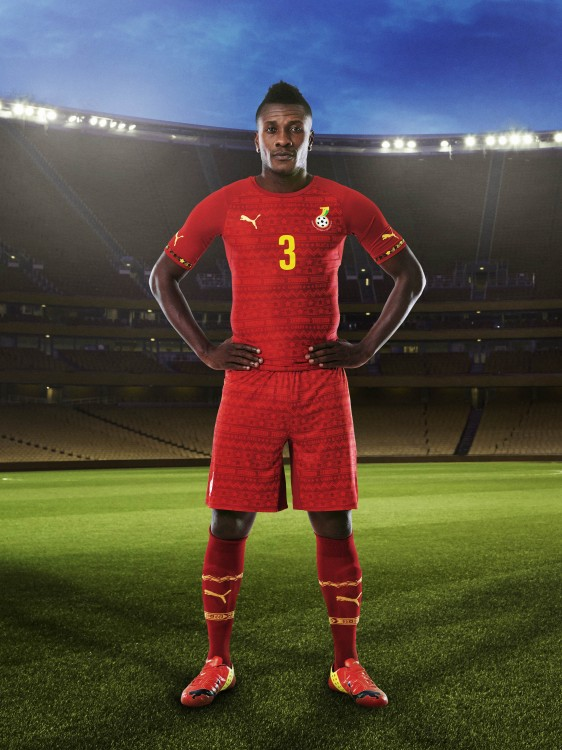 Asamoah Gyan in the 2014 Ghana Away Kit that features PUMA's PWR ACTV Technology