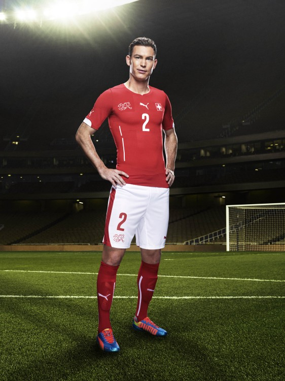Stephan Lichtsteiner in the 2014 Switzerland Home Kit that features PUMA's PWR ACTV Technology
