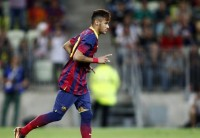 Barcelona's Neymar gestures as he runs during their friendly soccer match against Lechia Gdansk in Gdansk