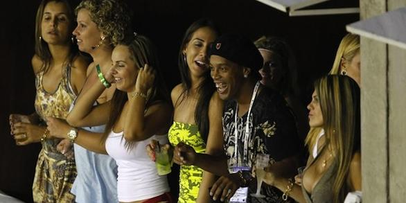 Brazilian soccer player Ronaldinho watches the annual carnival parade with his friends, in Rio de Janeiro's Sambadrome